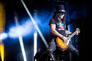 Slash says he doesn't know how he does it, but his signature top hat just always stays on when he's rocking out on stage.