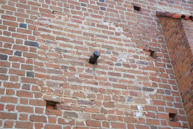 artillery shell in the wall - church