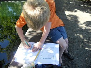 Photo: Nathan working on his Nature Scavenger hunt. I had them draw pictures of the various things they saw.