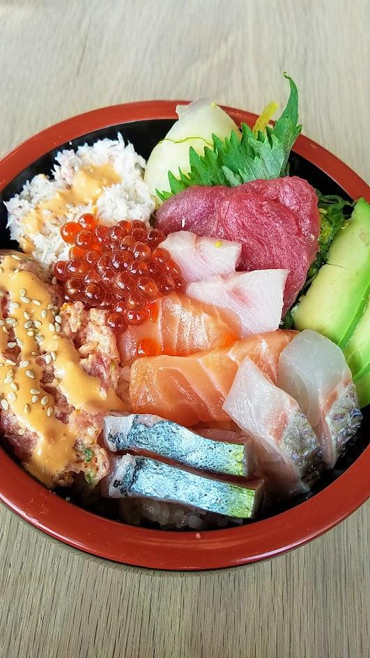Chirashi Bowl from Afuri with big eye tuna, yellowtail, striped jack, salmon, sea bream, salmon roe, spicy tuna, California crab, avocado, seaweed, and pickled ginger
