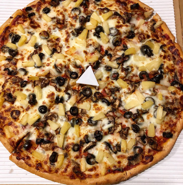 Large pizza with olives, mushrooms and pineapple
