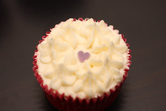 Photo: A simple cupcake with piped vanilla icing