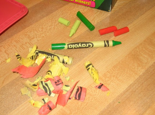 Peel crayons and break them into small pieces.