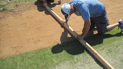 Photo: We do base paths the old fashioned way by running a 2X4 all the way down. This will get it almost perfect.