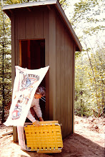 Photo: Storing chairs in outhouse (note the fancy curtain door).
