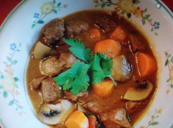 FOR: HEARTY SOUTHWEST STEW.  Brown ground beef with onion in a heavy skillet, stirring frequently,...