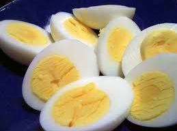 Gently slice eggs lengthwise and remove yolks, adding each to a medium sized bowl....