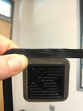 Photo: Otherwise identical rim from MakerGear black and RepRaper black. Both prints were under temperature for their respective filament, but look at the transmittance. difference.