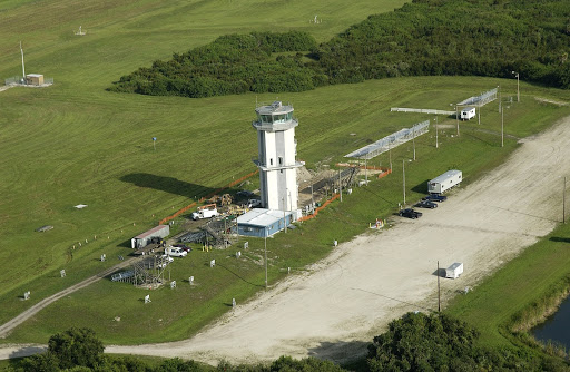 An aerial view of the control tower at the KSC Shuttle Landing Facility.