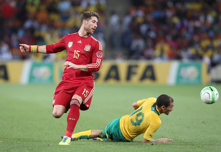 Bafana Bafana's Daylon Claasen fights for the ball with Spanish Defender Sergio Ramos during a friendly match at FNB stadium.