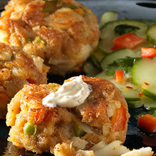 Dungeness Crab Cakes With Whole Grain Mustard Sauce and Cucumber Salad.