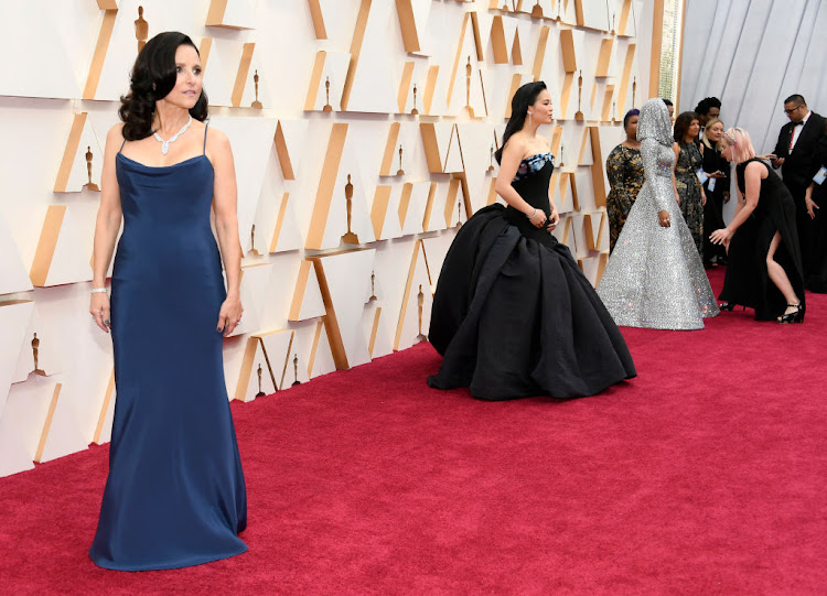 Cristina Ehrlich, who has dressed the likes of Laura Dern, Tina Fey and Julia Louis-Dreyfus (pictured here) expects to see plenty of glitz and glamour at Sunday's Oscars.