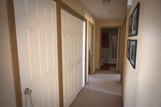 Photo: view of the hallway leading to the laundry area, bedrooms and directly into bathroom #1