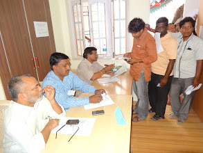 Photo: Voter displaying the Identity card to the election officer - GHMC Elections