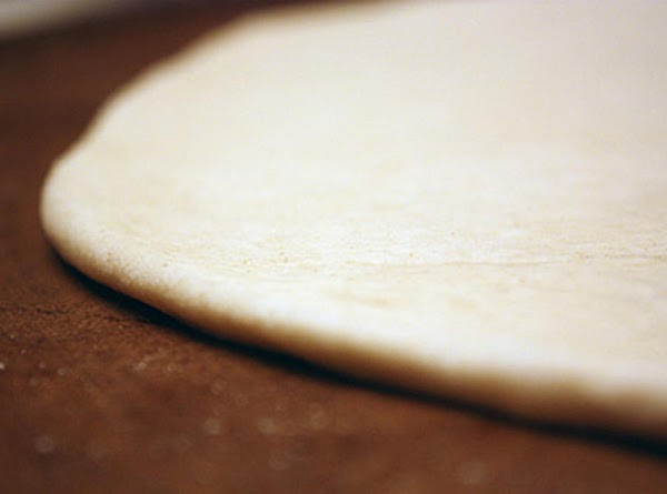 Unroll pizza crust on a cutting board. Spread curst into a 12x9 inch rectangle....