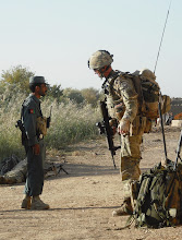 Photo: Sgt Steyn talks through the next phase of the plan with a local ANP Patrolman.---BRIT TROOPS' OPERATION TO TRAIN AFGHAN NATIONAL POLICESoldiers from The Argyll and Sutherland Highlanders, 5th Battalion The Royal Regiment of Scotland (5 SCOTS), have recently been involved in a three-day operation designed to test the mettle of the Afghan National Police (ANP).Operation TORA GHAR was organised by members of 5 SCOTS deployed in the Nad-e Ali area of Helmand province, as a Police Advisory Team. A unit of 12 men, the Police Advisory Team focuses on ensuring Afghan policemen deployed on the ground in Helmand are adhering to their correct procedures and training.