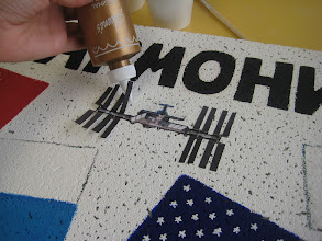 Photo: Gluing down the space station graphic (no way was I going to try to paint that!)