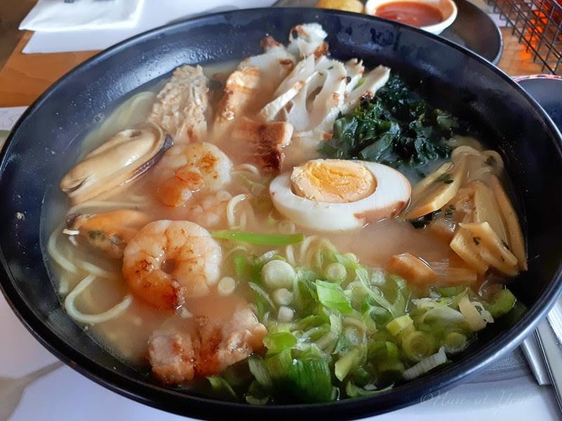 Wagamama ramen topped with seafood, veg, pork and half an egg