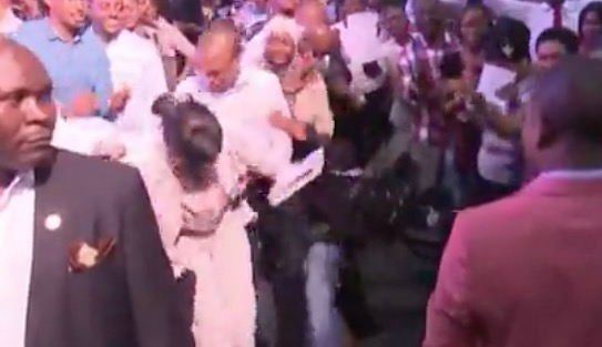 "Congregants ""fall"" to the ground after Bushiri blows into the microphone."