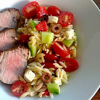 Souvlaki-Style Pork Tenderloin with a Tomato, Olive, Feta & Roasted Red Pepper Salad.