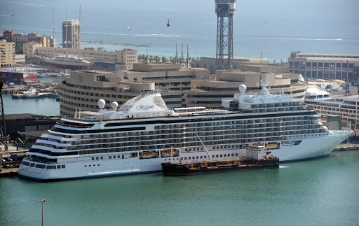 seven-seas-explorer-docked-in-barcelona-1.jpg - An overlook from the Park ay the Olympic area at the highest  hill of Barcelona with a view of the new Seven Seas Explorer.