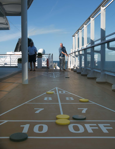 Guests playing shuffleboard on the sports deck of Viking Sun.