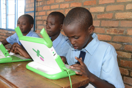 Pupil from Gahini Primary School work with their laptops. Photo/FILE
