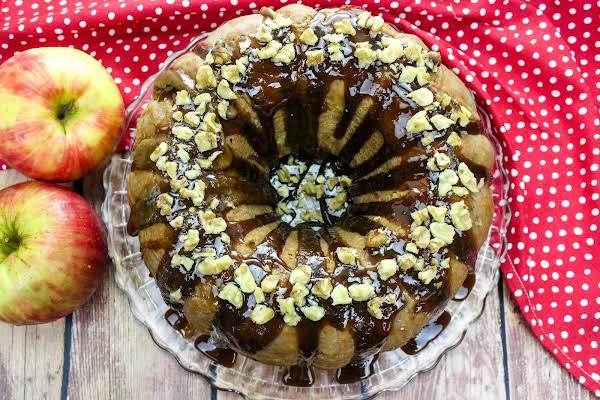 Carolina Apple Cake With Nuts Sprinkled On Top.