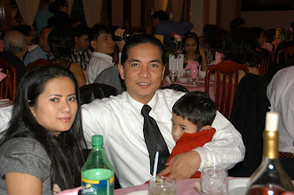 Photo: Mr Thavro Phin ,wife ,son