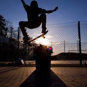 Ollie over a trash can by Pete Jones - Sports & Fitness Skateboarding