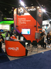 Photo: AMD's tiny lil' booth.  I heard a variety of interesting and wonderful things about AMD from people I'm inclined to believe.  It genuinely sounds like their lean period is coming to and end and they are about to have some very good years.