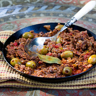Ground Beef Stew with Tomatoes Olives and Raisins