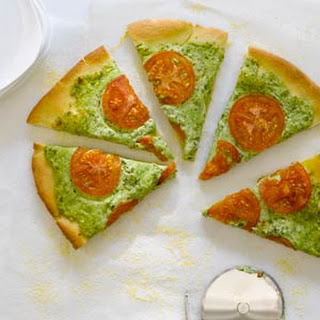 Arugula Pesto, Ricotta, and Smoked Mozzarella Pizza.