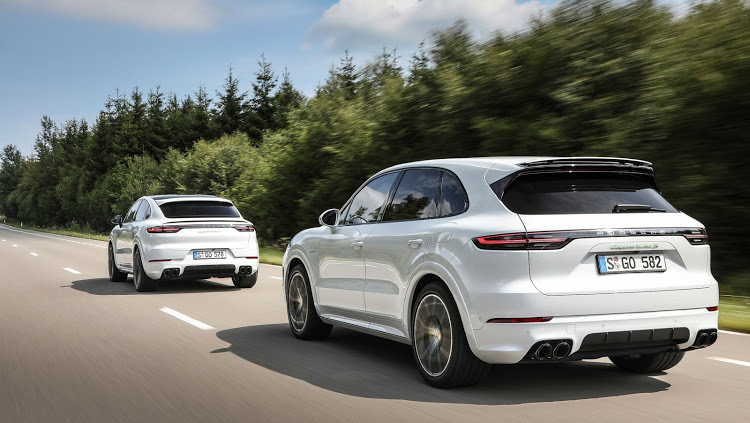 Cayenne (foreground) and its sleek Coupe cousin gain hybrid muscles.