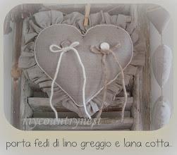 Photo: cuscino porta fedi in lino greggio con volant sfrangiato e filo di lana cotta per le fedi