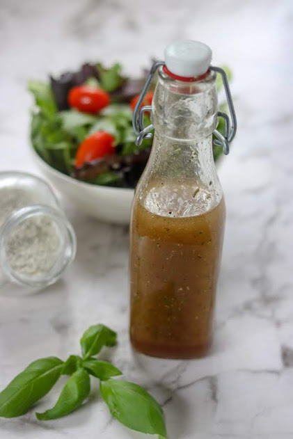 glass jar of homemade Italian dressing