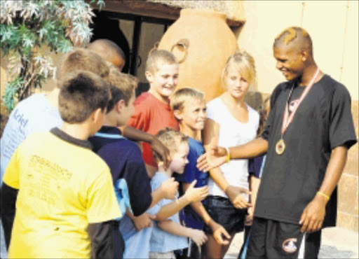 VICTORY: Terry van Rensburg, 16, from Westernburg, Polokwane, receives a hero's welcome after winning a gold medal at the 2010 Commonwealth Youth Wrestling Championships in Singapore. Pic. ELIJAR MUSHIANA. 13/01/2010. © Sowetan.  13 JANUARY 2010 WEDNESDAY: VICTORY: Terry Van Rensberg, 16, from Westernburg near Polokwane in Limpopo congratulates by his team mates after won gold medal in Singapore on 2010 Commonwealth Youth Wrestling Championshipsduring the welcoming ceremony held at Nguni Grill-Bendor, Polokwane in Limpopo on Tuesday. PHOTO: ELIJAR MUSHIANA