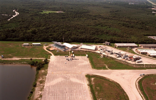 The News Center sits beyond a large parking lot on a hill at the northeastern end of the Launch Complex 39 Area.