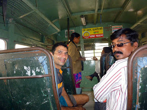 Photo: Me (Sunny Jamshedji) in a sneak shot of our lady bus conductor, which is apparently a rare sight in India. The state transport bus took us from Mahuli Village to Asangaon for the train ride back to Mumbai.