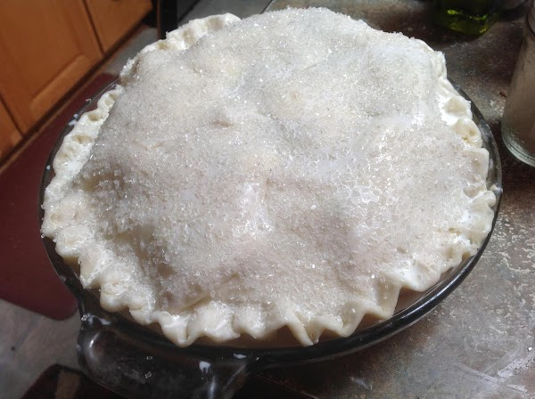 Add the top crust and pinch the bottom and top crust together then crimp...