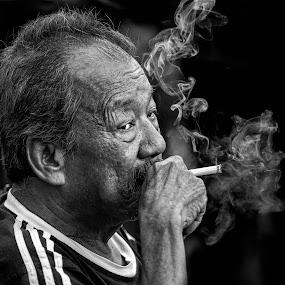 Life is good by Vijay Tripathi - People Portraits of Men ( cigarettes, streetphotography, black and white, smoke photography, old man, street scene, smoke, street photography )