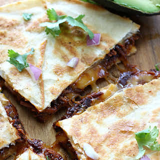 Slow Cooker BBQ Chicken Quesadillas with Bacon Avocado Dipping Sauce.