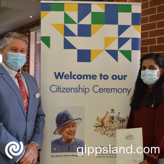 Davinder Kaur showing her Australian citizen certificate after the ceremony with Deputy Mayor, Cr Mark Reeves