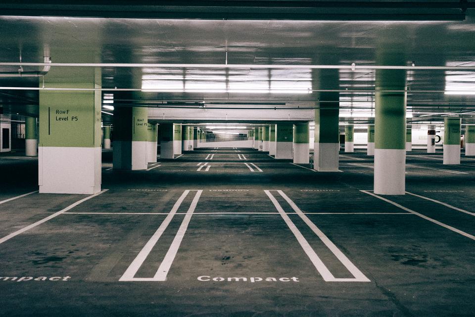 parking garage parking spaces pavement lines underground