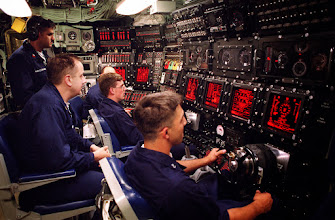 Photo: 970703-N-6483G-007 Personnel man the underway main control watch, aboard the NavyÕs newest nuclear powered submarine USS Seawolf (SSN 21). The Seawolf uses the latest technology in submarine warfare making it the fastest most versatile submarine in the U.S. undersea arsenal. She is scheduled to be commissioned on July 19th, 1997. U.S. Navy Photo by Chief Photographer John E. Gay (RELEASED).