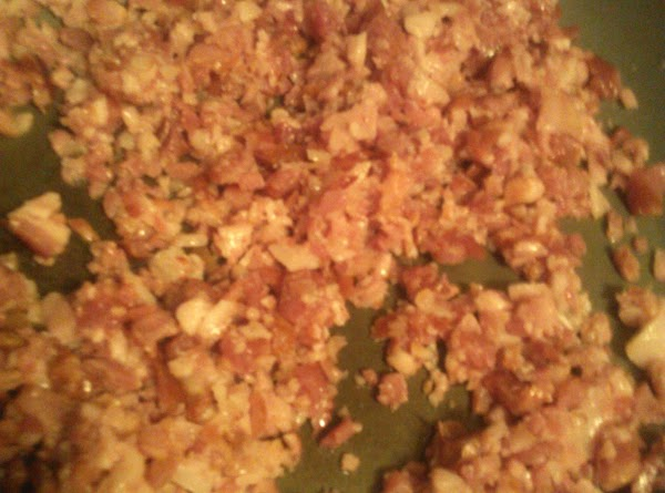 In a large skillet, cook the bacon until done, reserving the grease.  Set...
