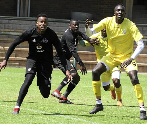 AmaTuks' striker Mame Niang, right, is marked by Pirates players Happy Jele and Ntsikelelo Nyauza during a friendly last week.