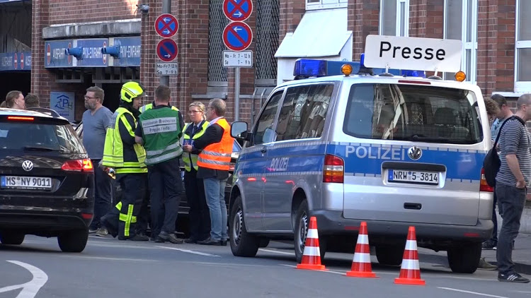 Police block a street near a place where a vehicle drove into a group of people killing several and injured many in Muenster Germany, April 7 2018.