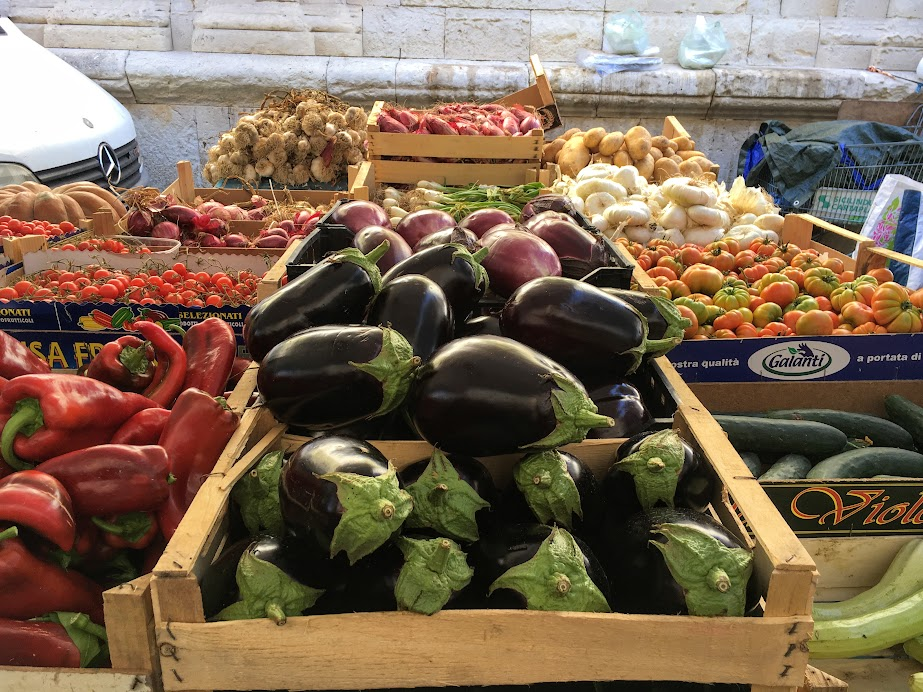 Colorful veggies in Ortigia Market - this makes me want to learn how to cook more than anything.