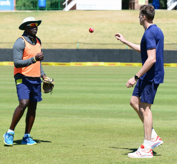 South Africa senior men's cricket team head coach Ottis Gibson tosses the ball to fast bowler Morne Morkel during the Proteas's training session and press conference at Senwes Park on September 27, 2017 in Potchefstroom, South Africa.